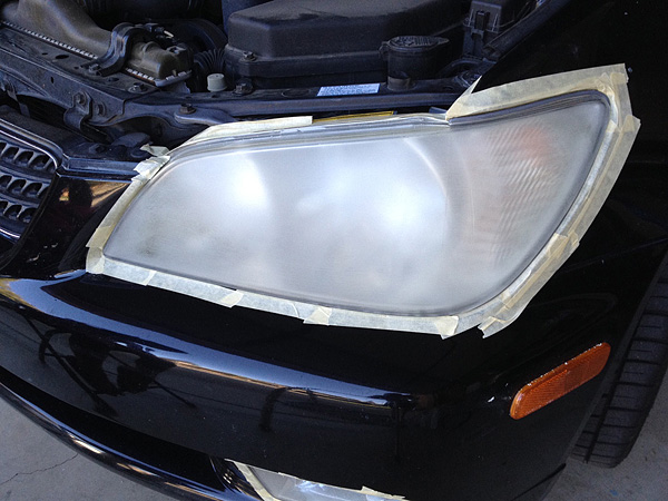 First step in headlight recondition is removing the outer layer of plastic with rough grit sandpapers.  It looks worse before it looks better.  The whole time you're worried you just committed yourself to shelling out $500 for new headlight housings.